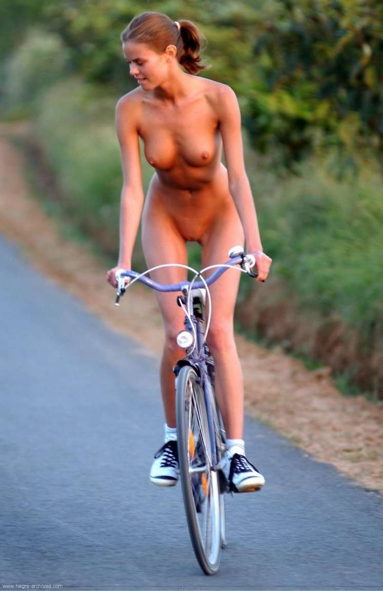 sexy naked girl on mountain bike