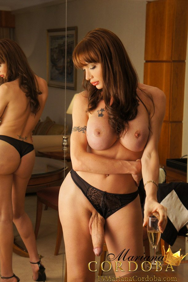 ts-mariana-cordoba-puts-her-giant-monster-cock-in-a-glass